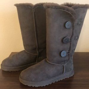 Tall Uggs with buttons.